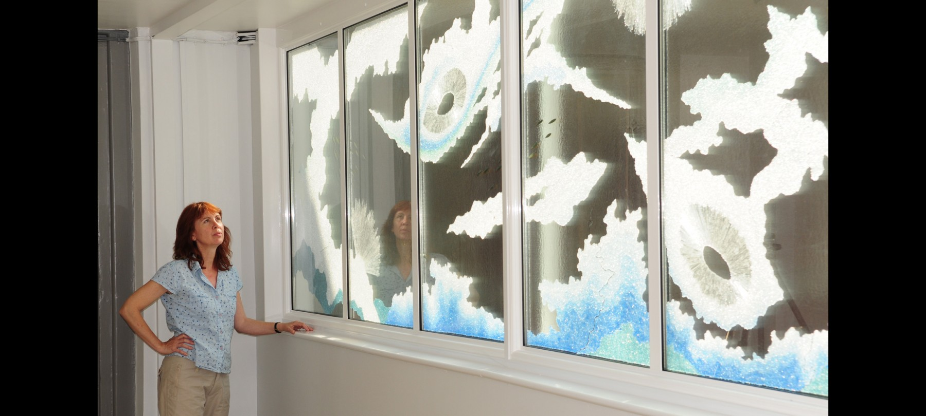 Karen Lawrence viewing Waterscape Window commission at Guy